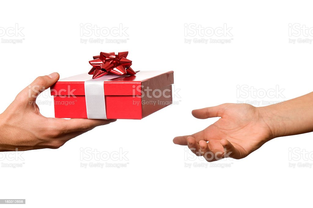 Hand outstretched to receive red and white wrapped gift stock photo