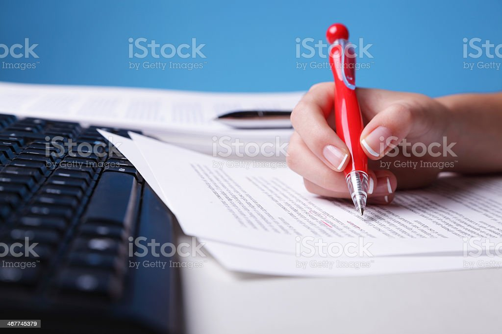Hand owner doing proof reading of assignment stock photo