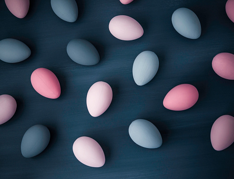 Hand painted gray and pink ombre Easter eggs background.