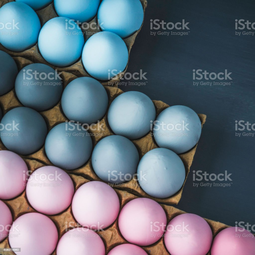 Hand painted gray, pink and blue ombre Easter eggs background stock photo
