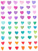 Hand painted hearts created with watercolors and ink. There are a set of twelve hearts, each painted in a different shade of rainbow colors. They are outlined in black ink. They are isolated on a white background for copy space. There is a subtle texture in the paint.