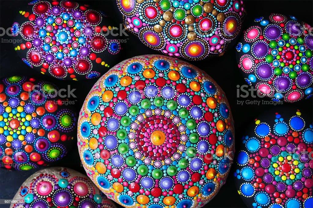 Hand painted mandala stones Hand painted mandala stones closeup Abstract Stock Photo