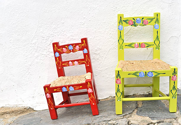 Hand painted rustic chairs in Portugal stock photo