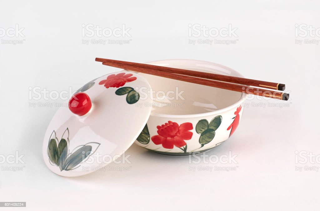 Hand painted soup bowl with cover and chopsticks isolated stock photo