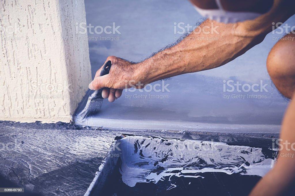 Hand painting garage floor, soft selective focus, toning stock photo