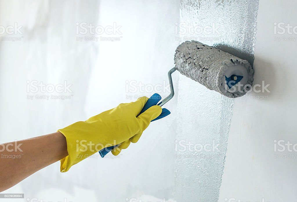 Hand painting wall in grey stock photo