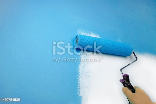 istock hand painting wall 450754505