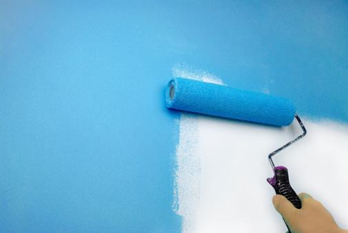 istock hand painting wall 450754505