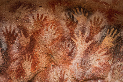 Prehistoric paintings of hands at the Cave of Hands (Spanish: Cueva de Las Manos) in Santa Cruz Province, Patagonia, Argentina. The art in the cave dates from 13,000 to 9,000 years ago.