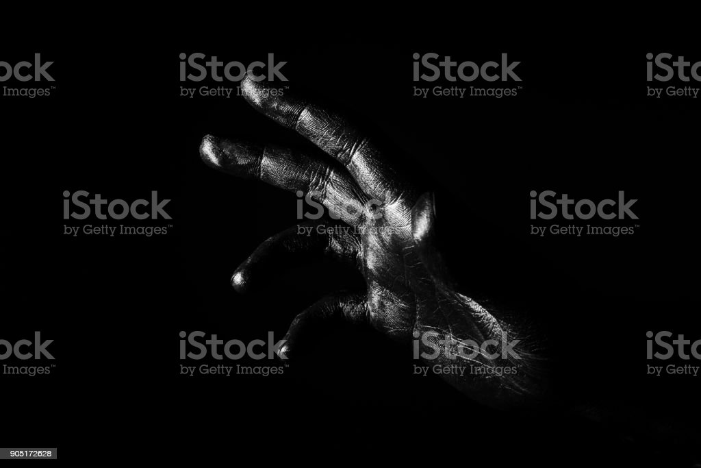 Hand palm of a man painted black stock photo