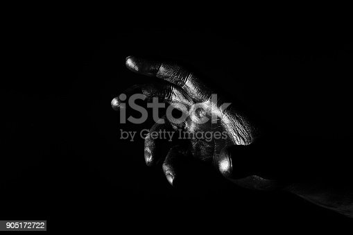 istock Hand palm of a man painted black 905172722