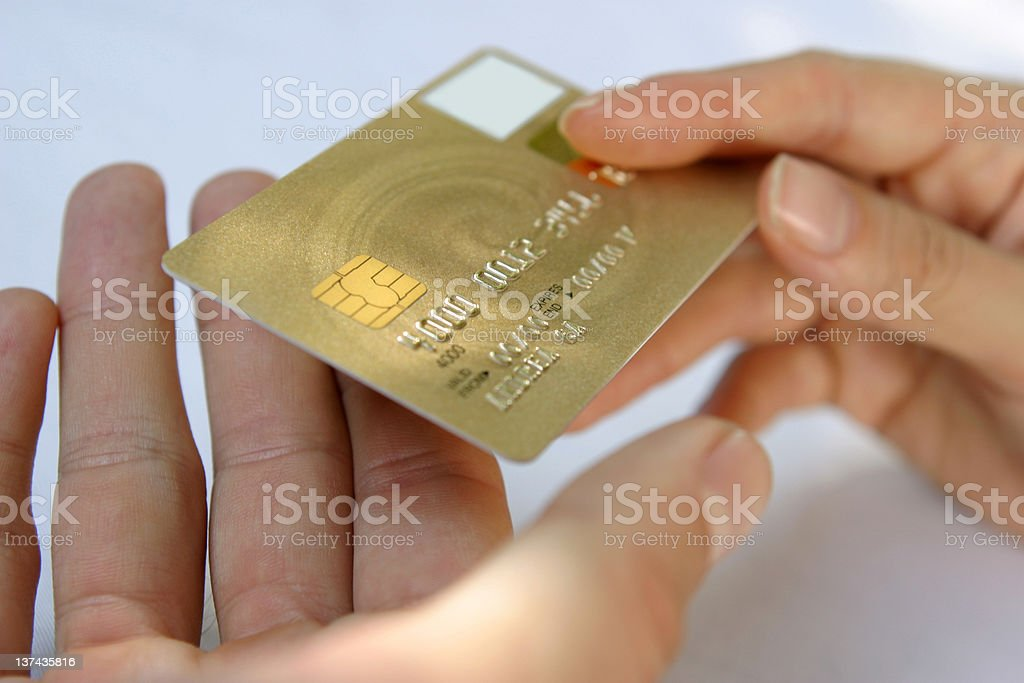 Hand passing a payment card (N.B. Mocked up details*) royalty-free stock photo