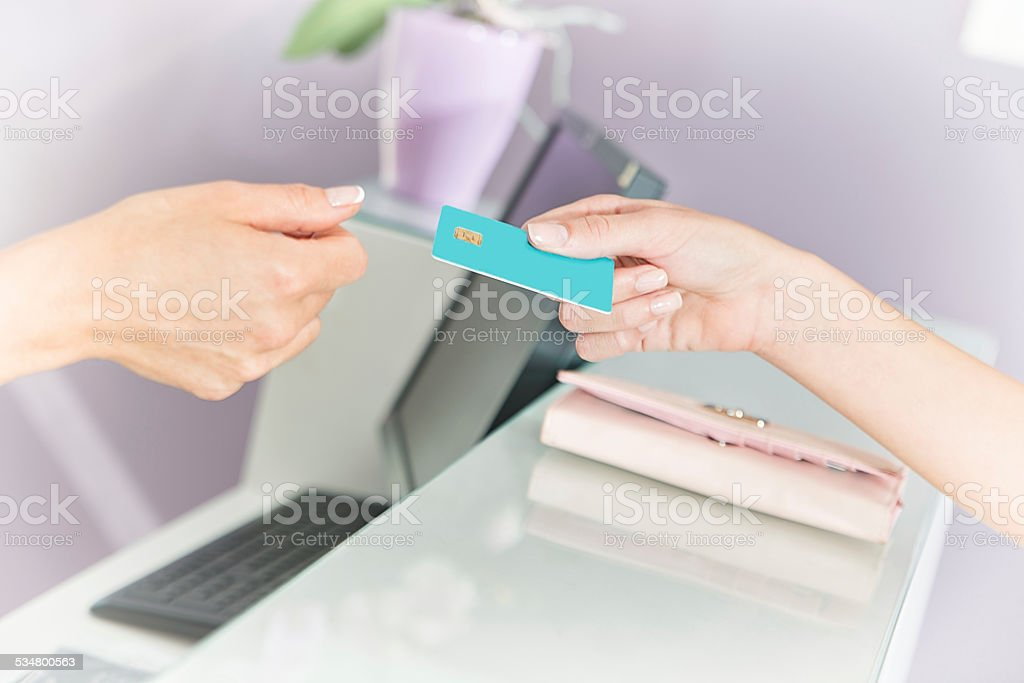 Hand passing a payment card stock photo