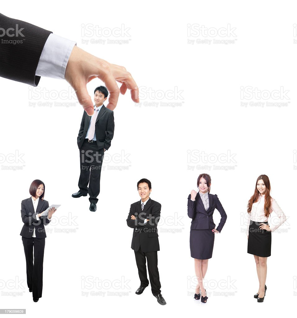 Hand picking up one of five business people royalty-free stock photo