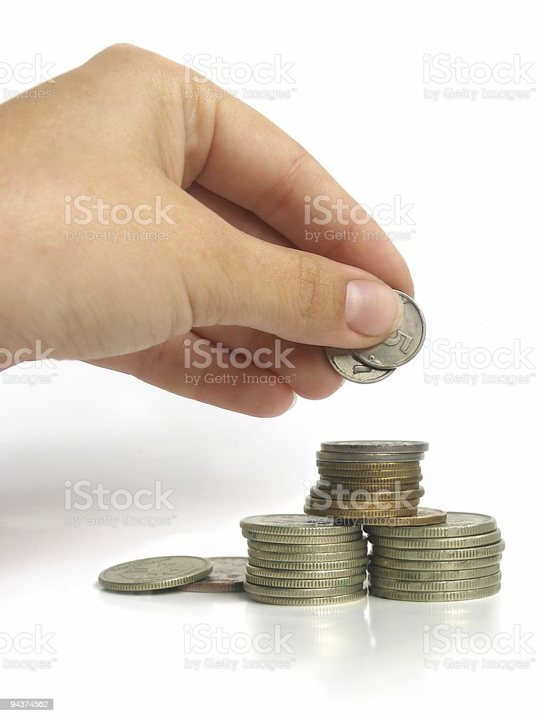 Hand picking up some coins royalty-free stock photo