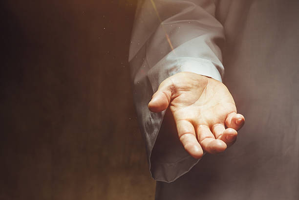 Hand Male hand reaching out clergy stock pictures, royalty-free photos & images