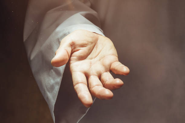 Hand Man showing open hand clergy stock pictures, royalty-free photos & images