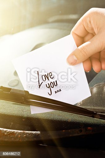 istock Hand places note reading