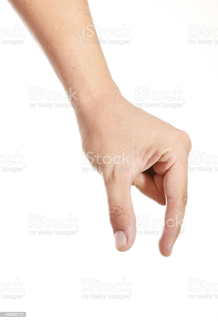Hand placing object on white background stock photo