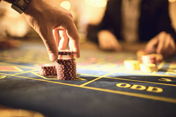 Hand players make bets chips to play roulette in a casino stock photo