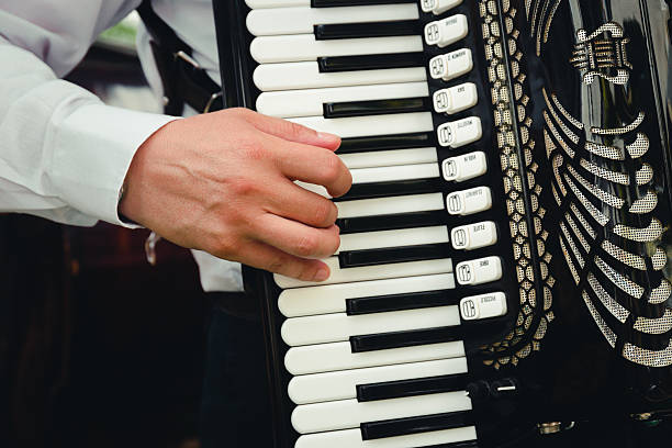 hand playing accordion closeup - accordion stock photos and pictures