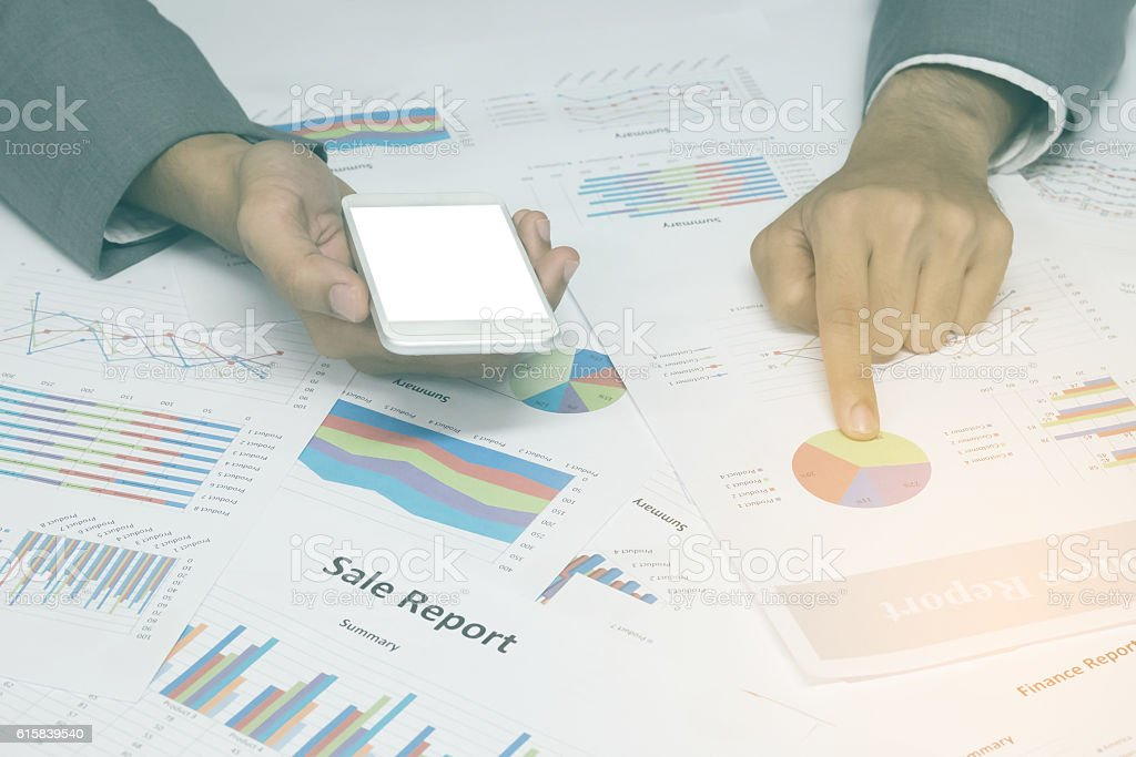 Hand point the business report of market share, hand stock photo