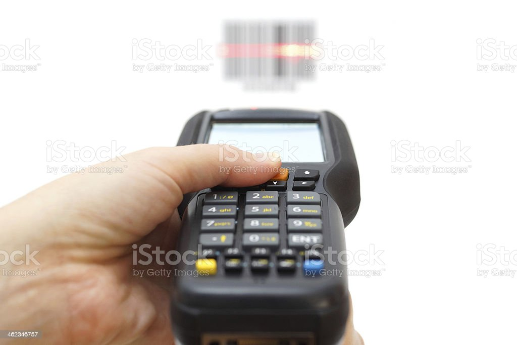Hand pointing a barcode reading device with laser stock photo