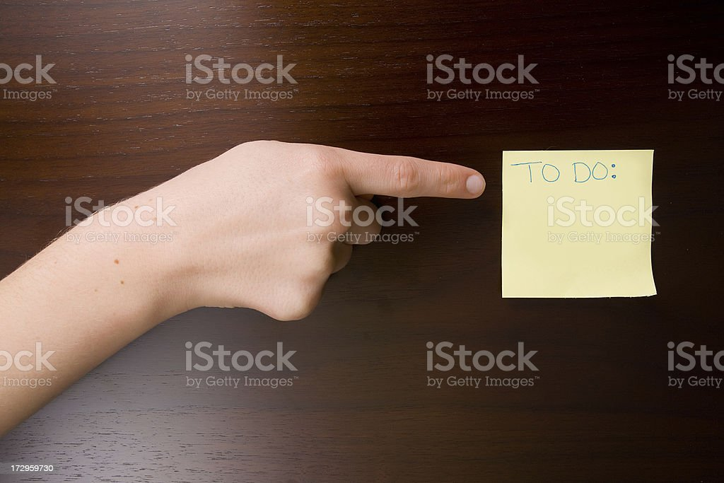 Hand Pointing at a Blank TO DO list royalty-free stock photo