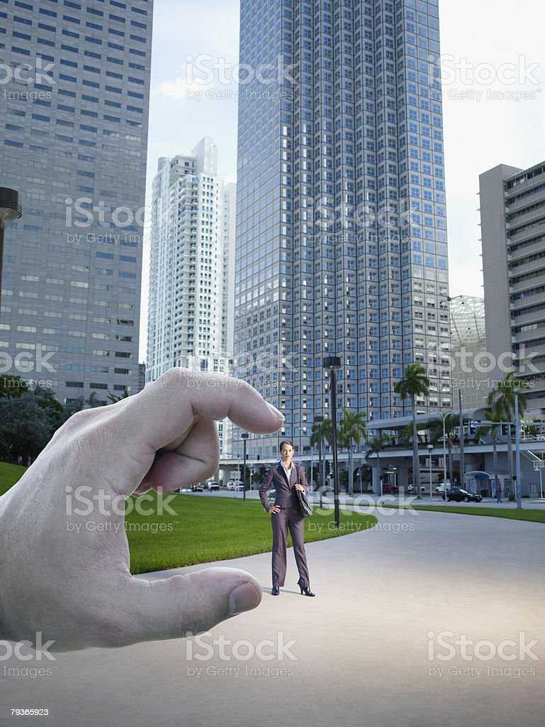 Hand pointing at businesswoman standing outdoors 免版稅 stock photo