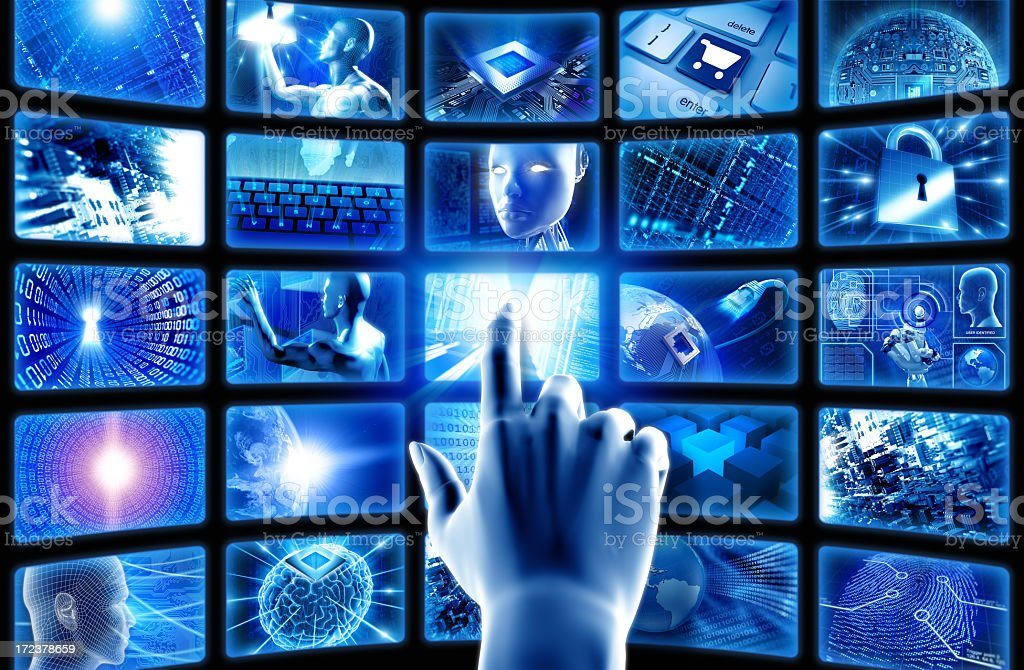 Hand pointing at hi-tech screens stock photo