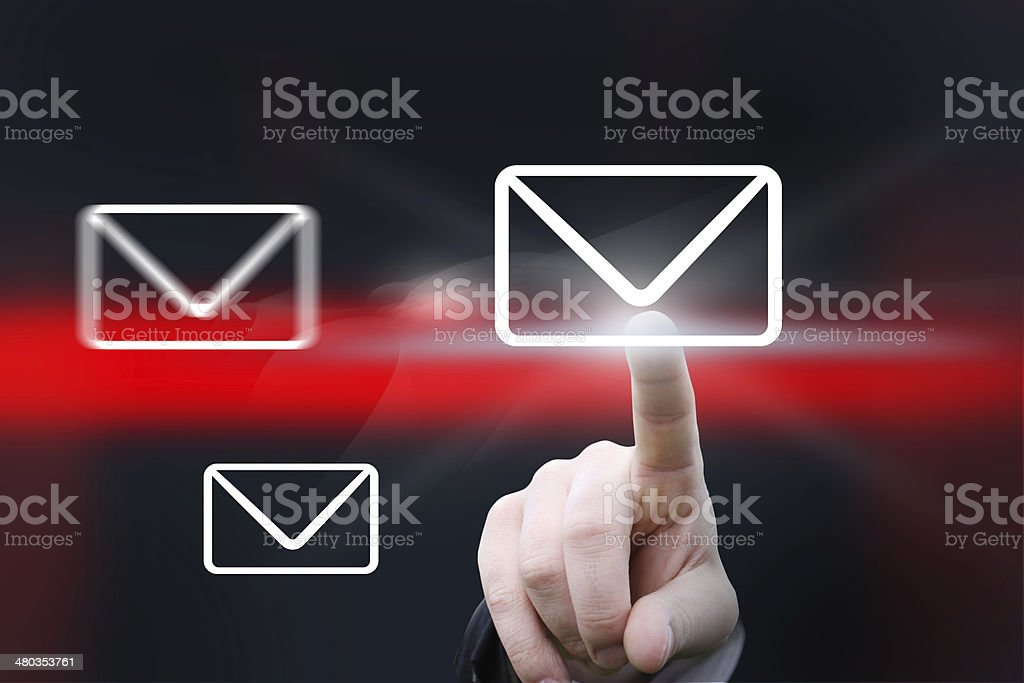 Hand pointing at mail icon stock photo