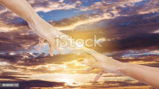 1035928092istockphoto Hand pointing finger, on sunset sky background 809668132