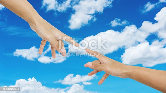 1035928092istockphoto Hand pointing finger together with ,on blue sky and white clouds background 809668604