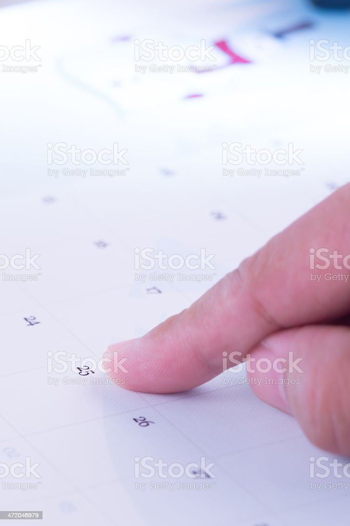 Hand Pointing on Date stock photo