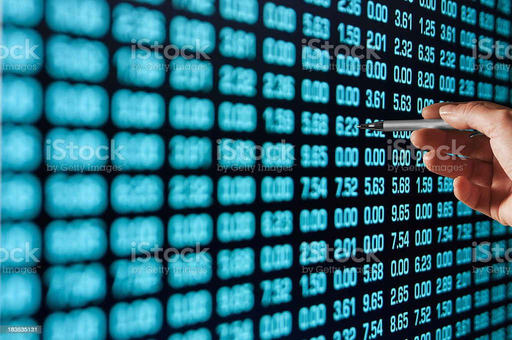 Hand pointing pen at binary code on screen stock photo