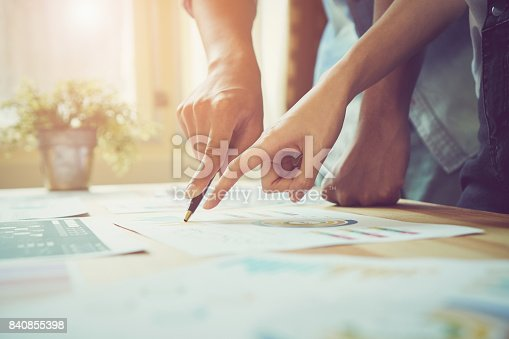 istock Hand pointing to a financial document on the desk. Between the agreed form of work to send customers. Teamwork ideas work best. 840855398