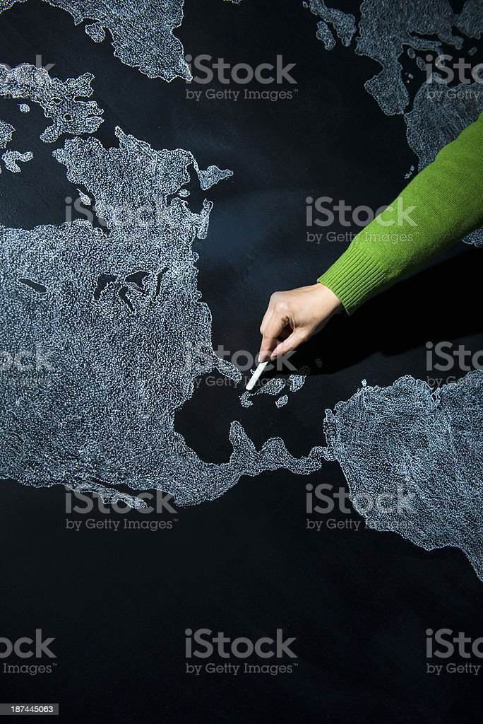 Hand pointing to Cuba, Caribbean Sea stock photo