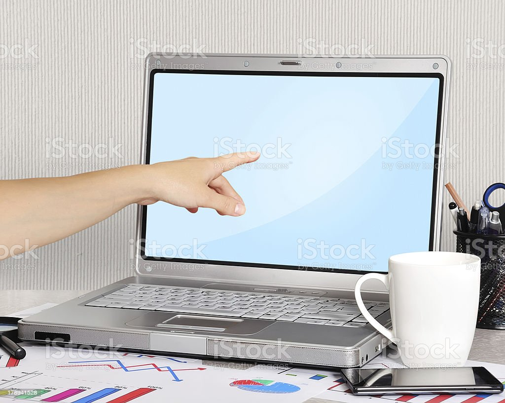 hand pointing to laptop royalty-free stock photo