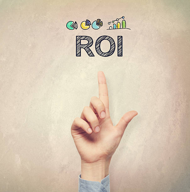 Hand pointing to ROI concept stock photo