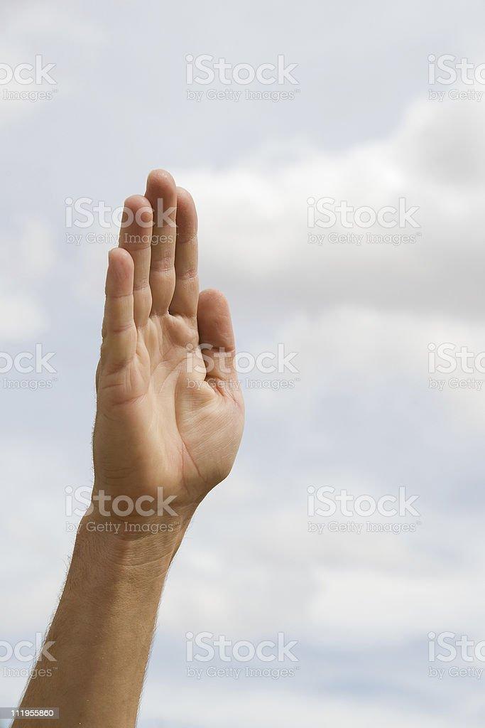 Hand pointing up aganst dark sky stock photo