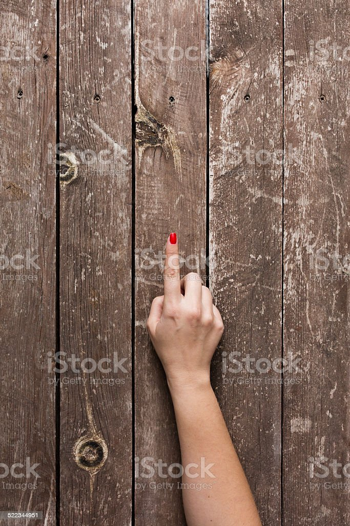 Hand pointing with wooden background stock photo