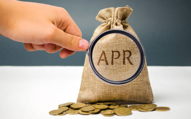 A hand points to a money bag with the word Apr. This is a financial fee, expressed as an annual rate. Applicable to loan, mortgage, credit card. Commercial money investment. APR. Percentage Rate A hand points to a money bag with the word Apr. This is a financial fee, expressed as an annual rate. Applicable to loan, mortgage, credit card. Commercial money investment. APR. Percentage Rate annual event stock pictures, royalty-free photos & images