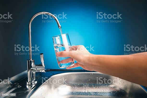 Hand pouring a glass of water from filter tap picture id543321900?b=1&k=6&m=543321900&s=612x612&h=fweckrq7lxiznbfcktyv6qlssvhlsryyijdzoctf9xo=