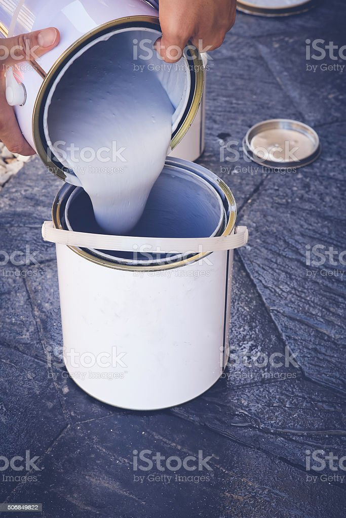Hand pouring paint, soft selective focus, toning stock photo