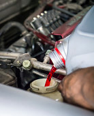 istock Hand pouring transmission fluid 510488501