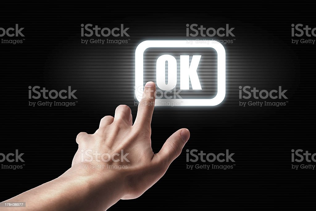 hand press ok button stock photo