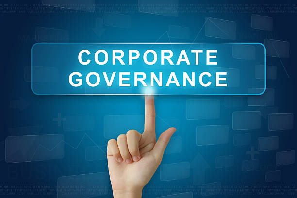 hand press on corporate governance or CG button stock photo