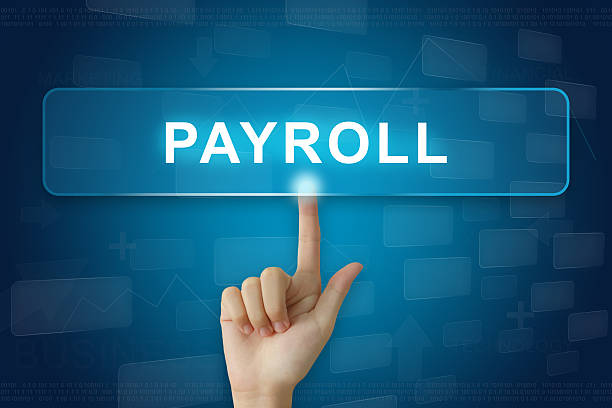 hand press on payroll button on touch screen stock photo