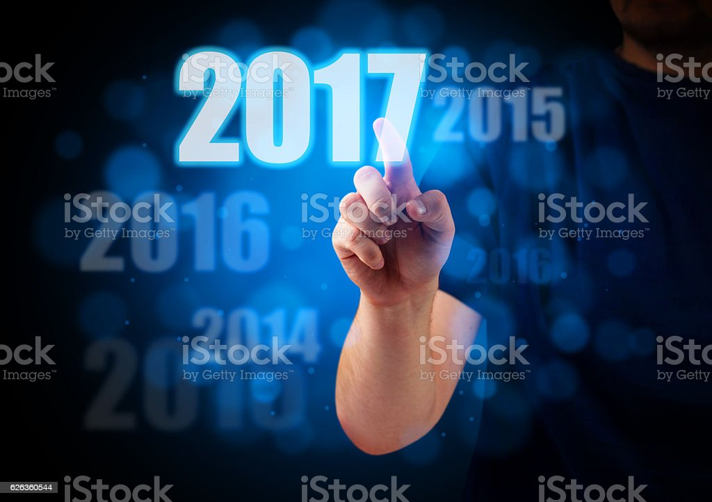 Hand pressing 2017 button stock photo