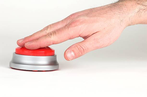 A hand pressing a big red button pushing a big red button push button stock pictures, royalty-free photos & images